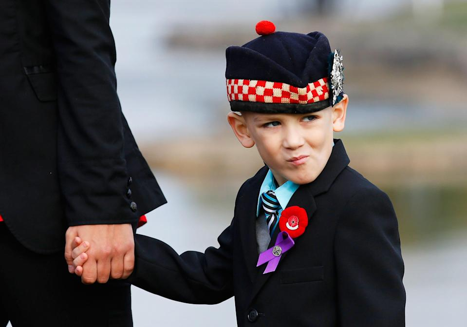 Marus Cirillo, 5, attends the funeral procession for his father, Cpl. Nathan Cirillo in Hamilton, Ontario October 28, 2014. Corporal Nathan Cirillo, 24, was one of two soldiers killed in a pair of attacks police said were carried out independently by radical recent converts to Islam at a time when Canada's military is stepping up its involvement in air strikes against Islamic State militants in the Middle East. REUTERS/Mark Blinch (CANADA - Tags: POLITICS MILITARY CRIME LAW OBITUARY)