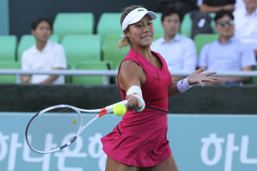 Kristie Ahn of the United States returns a shot to Ana Bogdan of Romania during their second round match of the Korea Open tennis championships in Seoul, South Korea, Wednesday, Sept. 18, 2019. (AP Photo/Ahn Young-joon)