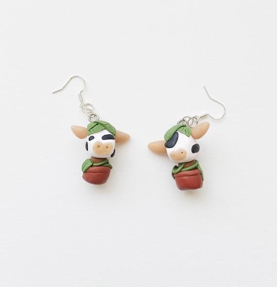 "<h2>Sims 4 Cowplant Earrings</h2><br>These earrings are a cute rendition of an unforgettable Sims world invention called the cowplant — a giant carnivorous plant that has a cow's head and eats characters that wander too close to it.<br><br><strong>Dangleandwhatnot</strong> Sims 4 Cowplant Earrings, $, available at <a href=""https://go.skimresources.com/?id=30283X879131&url=https%3A%2F%2Fwww.etsy.com%2Flisting%2F841891185%2Fsims-4-cowplant-earrings%3Fga_order%3Dmost_relevant%26ga_search_type%3Dall%26ga_view_type%3Dgallery%26ga_search_query%3Dsims%26ref%3Dsr_gallery-4-34%26organic_search_click%3D1%26pro%3D1%26frs%3D1"" rel=""nofollow noopener"" target=""_blank"" data-ylk=""slk:Etsy"" class=""link rapid-noclick-resp"">Etsy</a>"