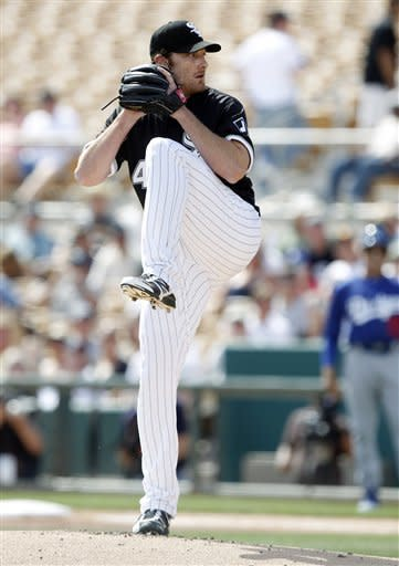 Chicago White Sox pitcher Phillip Humber winds up to deliver a pitch against the Los Angeles Dodgers in the first inning of a spring training baseball game Monday, March 5, 2012, in Glendale, Ariz. (AP Photo/Paul Connors)