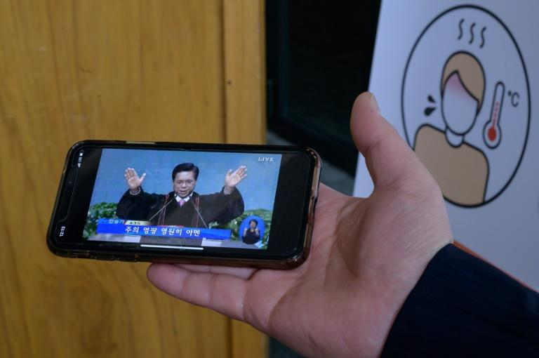 A church service is live-streamed by phone in Seoul