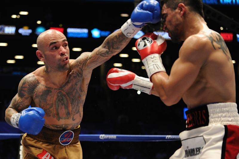 NEW YORK, NY - JANUARY 30: Luis Collazo punches Victor Ortiz during their WBA International Welterweight title fight at Barclays Center on January 30, 2014 in the Brooklyn borough of New York City. (Photo by Maddie Meyer/Getty Images)