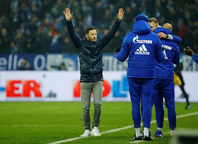 Soccer Football - Bundesliga - Schalke 04 vs TSG 1899 Hoffenheim - Veltins-Arena, Gelsenkirchen, Germany - February 17, 2018 Schalke coach Domenico Tedesco celebrates after the match REUTERS/Leon Kuegeler DFL RULES TO LIMIT THE ONLINE USAGE DURING MATCH TIME TO 15 PICTURES PER GAME. IMAGE SEQUENCES TO SIMULATE VIDEO IS NOT ALLOWED AT ANY TIME. FOR FURTHER QUERIES PLEASE CONTACT DFL DIRECTLY AT + 49 69 650050