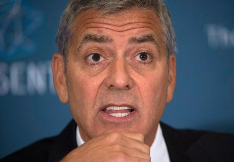 "Actor George Clooney, co-founder of Sentry, speaks during a news conference on September 12, 2016, in Washington, DC, to present the report ""War Crimes Shouldn't Pay: Stopping the looting and destruction in South Sudan"""