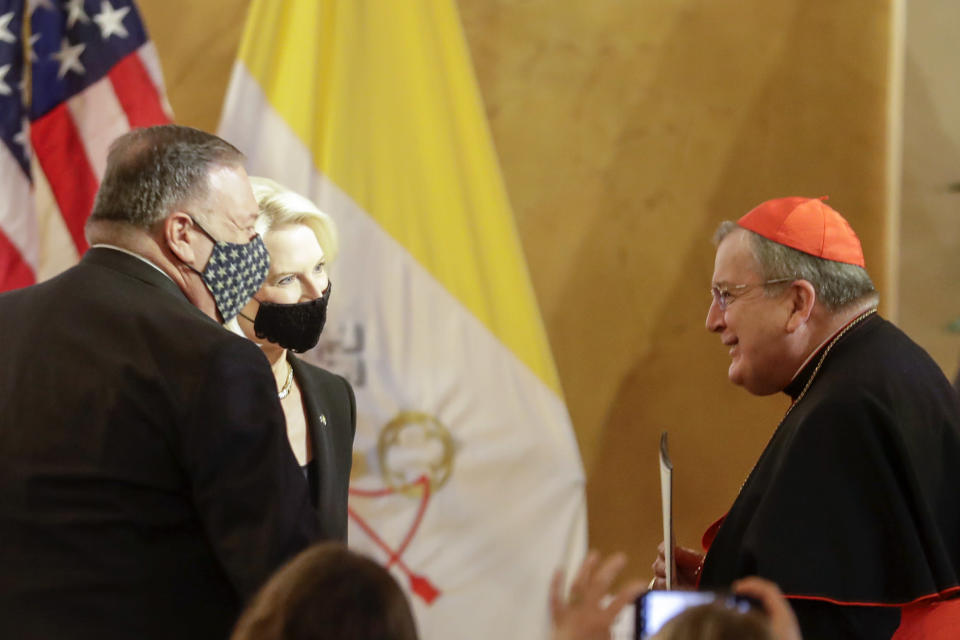 "U.S. Secretary of State Mike Pompeo, left, and U.S. Ambassador to the Holy See Callista Gingrich greet Cardinal Raymond Burke, right, as they attend the ""Advancing and Defending International Religious Freedom Through Diplomacy"" symposium, in Rome, Wednesday, Sept. 30, 2020. (AP Photo/Andrew Medichini)"