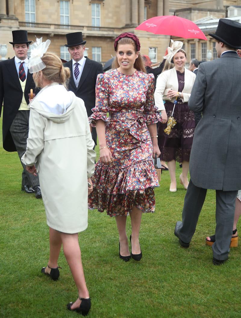 Princess Beatrice wearing The Vampire's Wife and a headband at the Queen's Garden Party in May 29, 2019. [Photo: Getty]