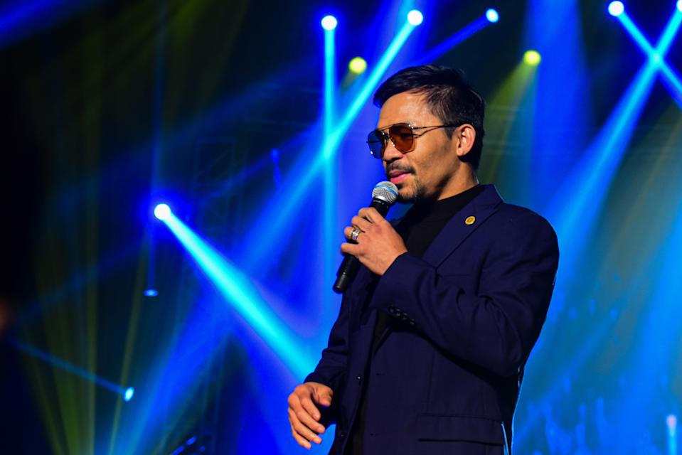 In this photo taken September 1, 2019, Filipino boxing icon Manny Pacquiao performs during a free concert to coincide with the launching of his own cryptocurrency