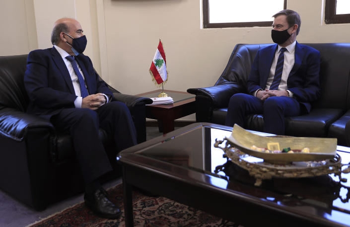 U.S. Undersecretary of State for Political Affairs David Hale, right, meets with the Lebanese Foreign Minister Charbel Wehbe, in Beirut, Lebanon, Wednesday, April 14, 2021. Hale berated Lebanese officials for fighting over the shape of a new government for months while millions of Lebanese endure mounting economic and social hardship. (AP Photo/Hussein Malla)