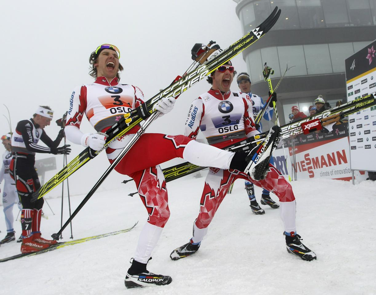 Canada's gold medalists Devon Kershaw (L) and Alex Harvey (R) celebrate by playing air guitar on their skis after crossing the finish line in the Men's Team Sprint Classic event at the Nordic Skiing World Championships in Oslo, March 2, 2011.  AFP PHOTO/ DANIEL SANNUM LAUTEN (Photo credit should read DANIEL SANNUM LAUTEN/AFP/Getty Images)