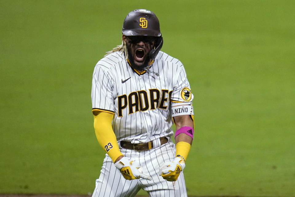 San Diego Padres' Fernando Tatis Jr. reacts after hitting a three-run home run during the sixth inning of Game 2 of the team's National League wild-card baseball series against the St. Louis Cardinals, Thursday, Oct. 1, 2020, in San Diego. (AP Photo/Gregory Bull)