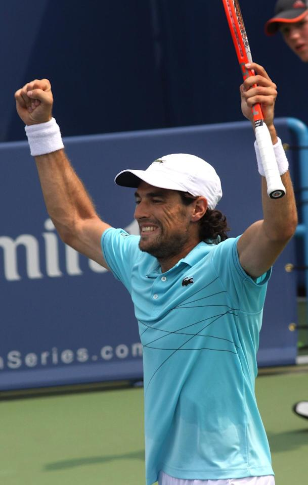 Jeremy Chardy, of France, reacts after beating Andy Murray, of Great Britain, 6-4, 6-4, in the Western & Southern Open tennis tournament, Thursday Aug. 16, 2012, in Mason, Ohio. (AP Photo/Tom Uhlman)