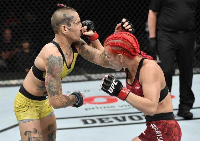 (R-L) Gillian Robertson punches Sarah Frota in their flyweight bout during UFC 240 at Rogers Place on July 27, 2019 in Edmonton, Alberta, Canada. (Jeff Bottari/Zuffa LLC)