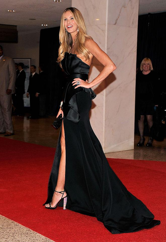 "<p class=""MsoNormal"">Supermodel and ""Fashion Star"" hostess with the mostest Elle Macpherson showed off one of her stems a la Angelina Jolie in a black gown, which featured a thigh-high slit, structured bodice, and lengthy train.</p>"