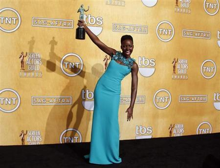 Lupita Nyong'o poses with her award at the 20th annual Screen Actors Guild Awards in Los Angeles