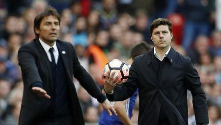 Britain Soccer Football - Tottenham Hotspur v Chelsea - FA Cup Semi Final - Wembley Stadium - 22/4/17 Tottenham manager Mauricio Pochettino looks dejected as Chelsea manager Antonio Conte gestures Action Images via Reuters / John Sibley Livepic