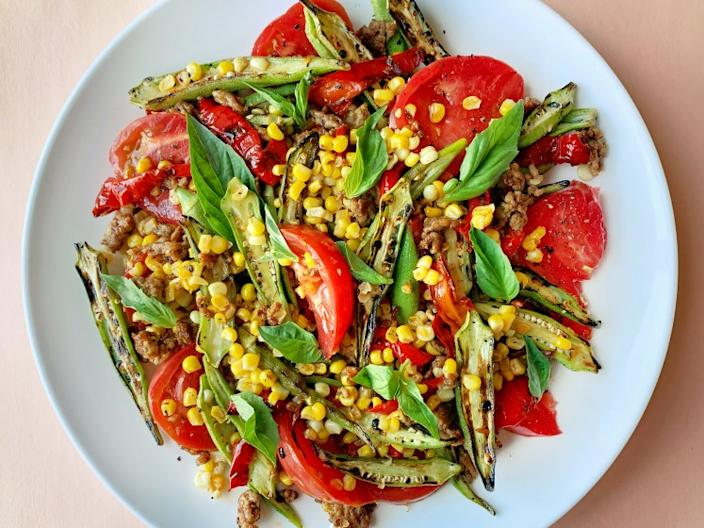 """Charred okra, corn and Jimmy Nardello peppers combine in this ode-to-summer dish. <span class=""""copyright"""">(Ben Mims / Los Angeles Times)</span>"""