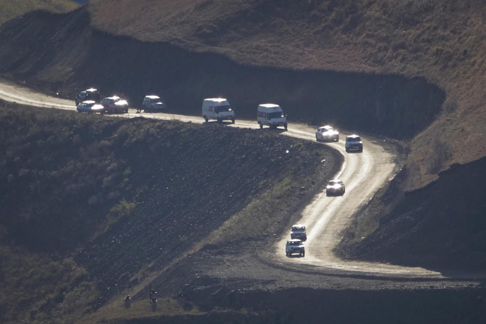 Cars with people leaving the separatist region of Nagorno-Karabakh to Armenia approach the border of Armenia, Sunday, Nov. 8, 2020. (AP Photo)