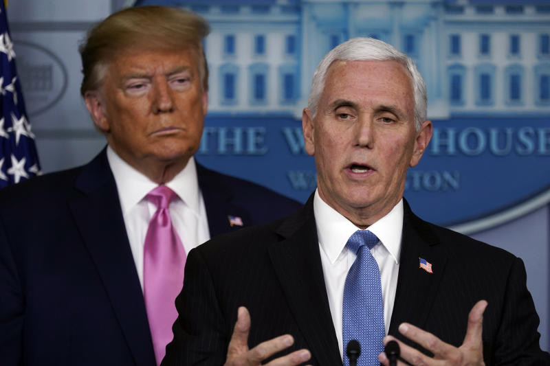 Vice President Mike Pence speaks as President Donald Trump listens during a news conference about the coronavirus in the Brady Press Briefing Room of the White House, Wednesday, Feb. 26, 2020, in Washington. (AP Photo/Evan Vucci)