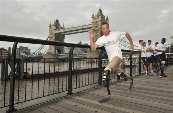 Paralympian Oscar Pistorius of South Africa poses for photographers during a photo-call near Tower Bridge in London September 7, 2011.