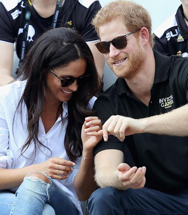 TORONTO, ON – SEPTEMBER 25: Prince Harry (R) and Meghan Markle (L) attend a Wheelchair Tennis match during the Invictus Games 2017 at Nathan Philips Square on September 25, 2017 in Toronto, Canada (Photo: Chris Jackson/Getty Images for the Invictus Games Foundation )