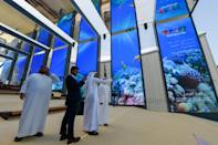 Visitors are pictured in the Israel pavilion during a media tour on September 27, 2021 ahead of the official opening of Dubai Expo 2020 (AFP/-)