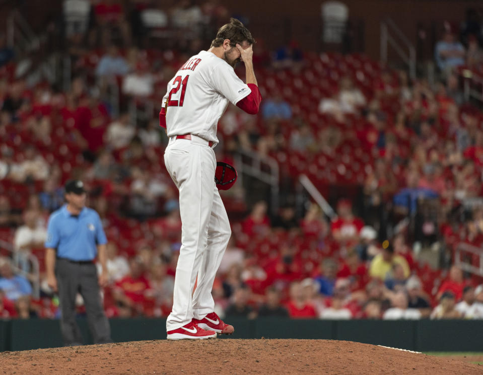St. Louis Cardinals relief pitcher Andrew Miller reacts after giving up a two-run home run to Miami Marlins' JT Riddle during the 11th inning of a baseball game Thursday, June 20, 2019, in St. Louis. (AP Photo/L.G. Patterson)