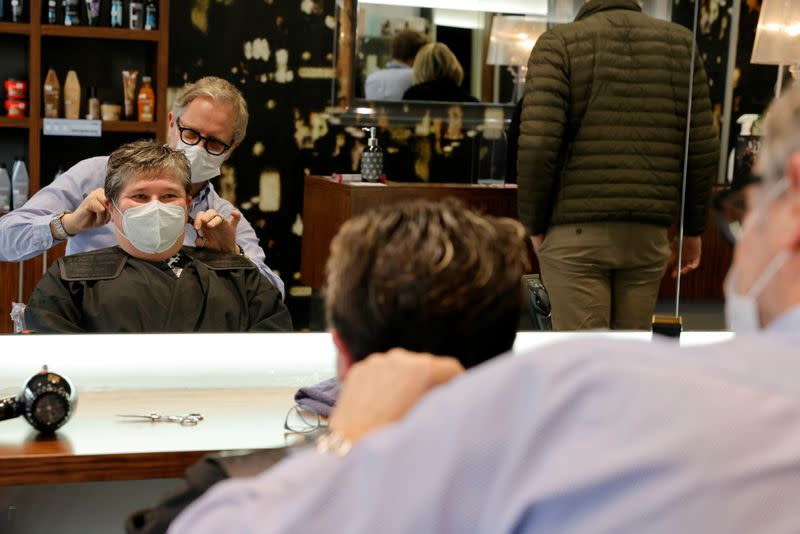 A hairdresser works in his shop in Cambrai a few hours before introducing a new lockdown