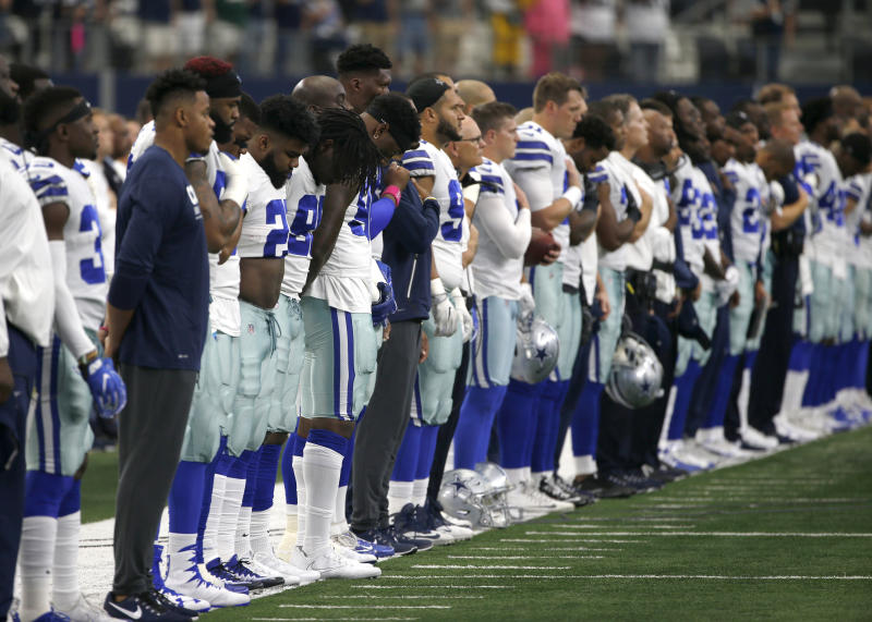 The Cowboys were in alignment during the playing of the national anthem on Sunday. (AP)