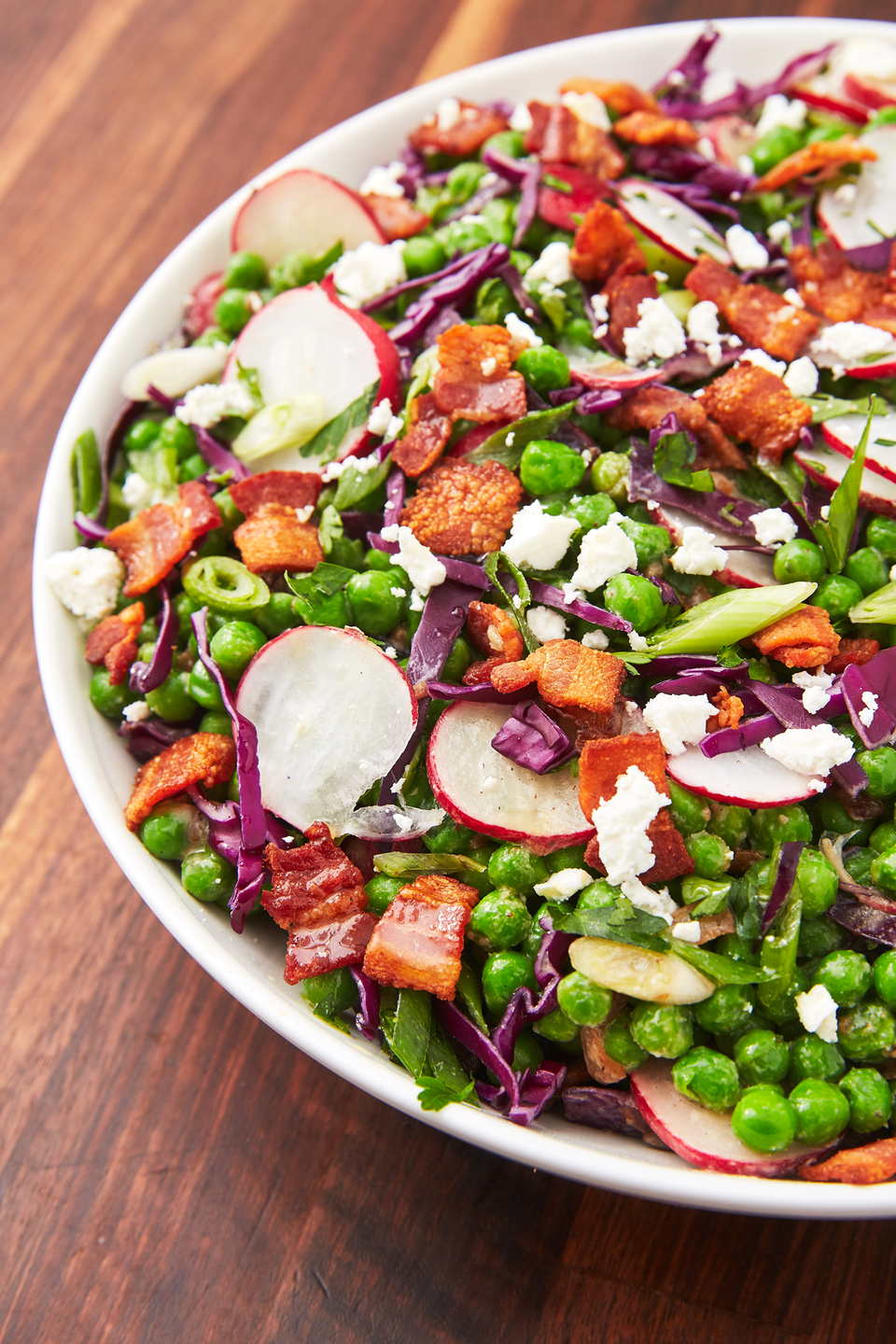 """<p>This side dish will liven up any weeknight dinner.</p><p>Get the recipe from <a href=""""https://www.delish.com/cooking/recipe-ideas/a27243978/pea-salad-recipe/"""" rel=""""nofollow noopener"""" target=""""_blank"""" data-ylk=""""slk:Delish"""" class=""""link rapid-noclick-resp"""">Delish</a>. </p>"""