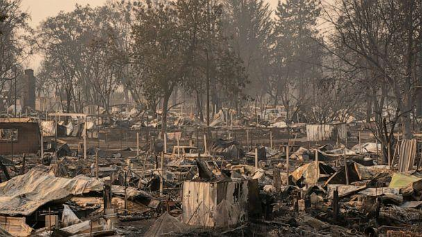 PHOTO: Damaged homes and cars are seen in a mobile home park destroyed by fire, Sept. 10, 2020, in Phoenix, Ore. (David Ryder/Getty Images)