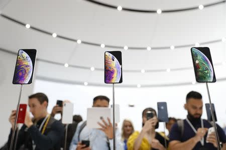 A demonstration of the newly released Apple products is seen following the product launch event in Cupertino