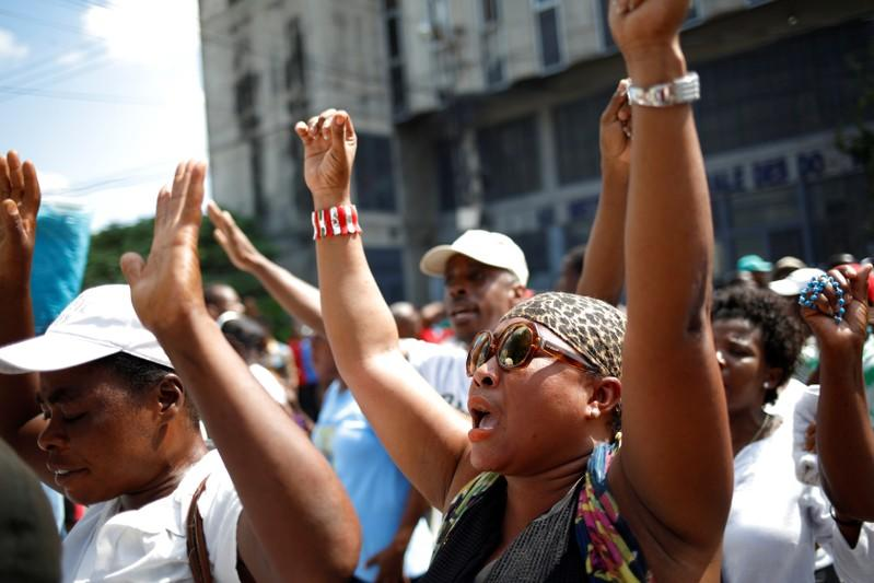 Haitian Catholics march for political reform as protests spread