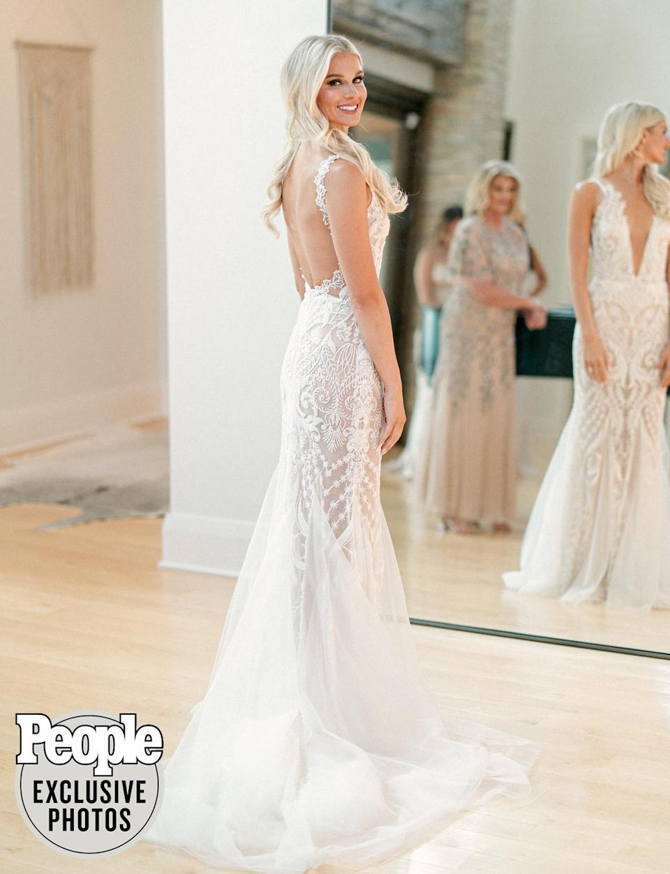 """<p>Parker wore a <a href=""""https://www.galialahav.com/"""" rel=""""nofollow noopener"""" target=""""_blank"""" data-ylk=""""slk:Galia Lahav"""" class=""""link rapid-noclick-resp"""">Galia Lahav</a> gown that she found at <a href=""""https://www.thedresstheory.com/nashville"""" rel=""""nofollow noopener"""" target=""""_blank"""" data-ylk=""""slk:The Dress Theory Nashville"""" class=""""link rapid-noclick-resp"""">The Dress Theory Nashville</a> much quicker than she initially expected.</p> <p>""""It was probably the third dress that I tried on, and I knew it immediately. I had five girls [including bridesmaids <a href=""""https://people.com/country/dan-smyers-marries-abby-law/"""" rel=""""nofollow noopener"""" target=""""_blank"""" data-ylk=""""slk:Abby Smyers"""" class=""""link rapid-noclick-resp"""">Abby Smyers</a> and <em>Bobby Bones Show</em> personality <a href=""""http://radioamy.com/"""" rel=""""nofollow noopener"""" target=""""_blank"""" data-ylk=""""slk:Amy Brown"""" class=""""link rapid-noclick-resp"""">Amy Brown</a>] with me and three of them started crying! It was the absolute opposite of what I thought that I wanted from the start — completely different,"""" she tells PEOPLE. </p> <p>Parker finished her bridal look with hair by <a href=""""https://www.instagram.com/sarahcklein/"""" rel=""""nofollow noopener"""" target=""""_blank"""" data-ylk=""""slk:Sarah Klein"""" class=""""link rapid-noclick-resp"""">Sarah Klein</a> and makeup by <a href=""""https://www.marzcollins.com/"""" rel=""""nofollow noopener"""" target=""""_blank"""" data-ylk=""""slk:Marz Collins"""" class=""""link rapid-noclick-resp"""">Marz Collins</a>.</p>"""
