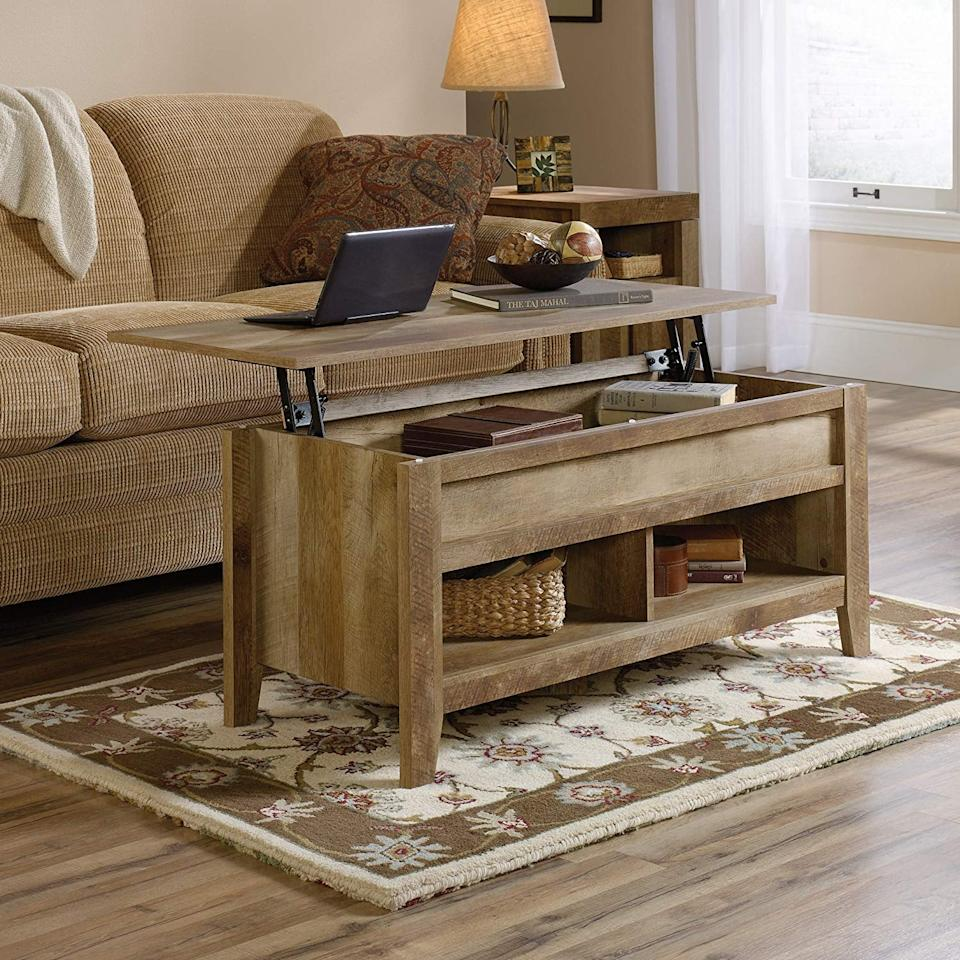 """<p>You can easily work on your computer with this <a href=""""https://www.popsugar.com/buy/Sauder-Dakota-Pass-Lift-Top-Coffee-Table-424192?p_name=Sauder%20Dakota%20Pass%20Lift-Top%20Coffee%20Table&retailer=amazon.com&pid=424192&price=168&evar1=casa%3Aus&evar9=46520015&evar98=https%3A%2F%2Fwww.popsugar.com%2Fhome%2Fphoto-gallery%2F46520015%2Fimage%2F46520081%2FSauder-Dakota-Pass-Lift-Top-Coffee-Table&list1=shopping%2Cfurniture%2Csmall%20space%20living%2Cliving%20rooms%2Chome%20shopping&prop13=mobile&pdata=1"""" rel=""""nofollow"""" data-shoppable-link=""""1"""" target=""""_blank"""" class=""""ga-track"""" data-ga-category=""""Related"""" data-ga-label=""""https://www.amazon.com/Sauder-Coffee-Table-Furniture-Craftsman/dp/B01DYR1KHW/ref=sr_1_2?keywords=coffee+table+under+%24200&amp;qid=1553018996&amp;s=gateway&amp;sr=8-2"""" data-ga-action=""""In-Line Links"""">Sauder Dakota Pass Lift-Top Coffee Table</a> ($168).</p>"""
