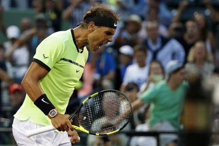 Mar 26, 2017; Miami, FL, USA; Rafael Nadal of Spain celebrates after winning match point against Philip Kohlschreiber of Germany (not pictured) on day six of the 2017 Miami Open at Crandon Park Tennis Center. Nadal won 0-6, 6-2, 6-3. Mandatory Credit: Geoff Burke-USA TODAY Sports