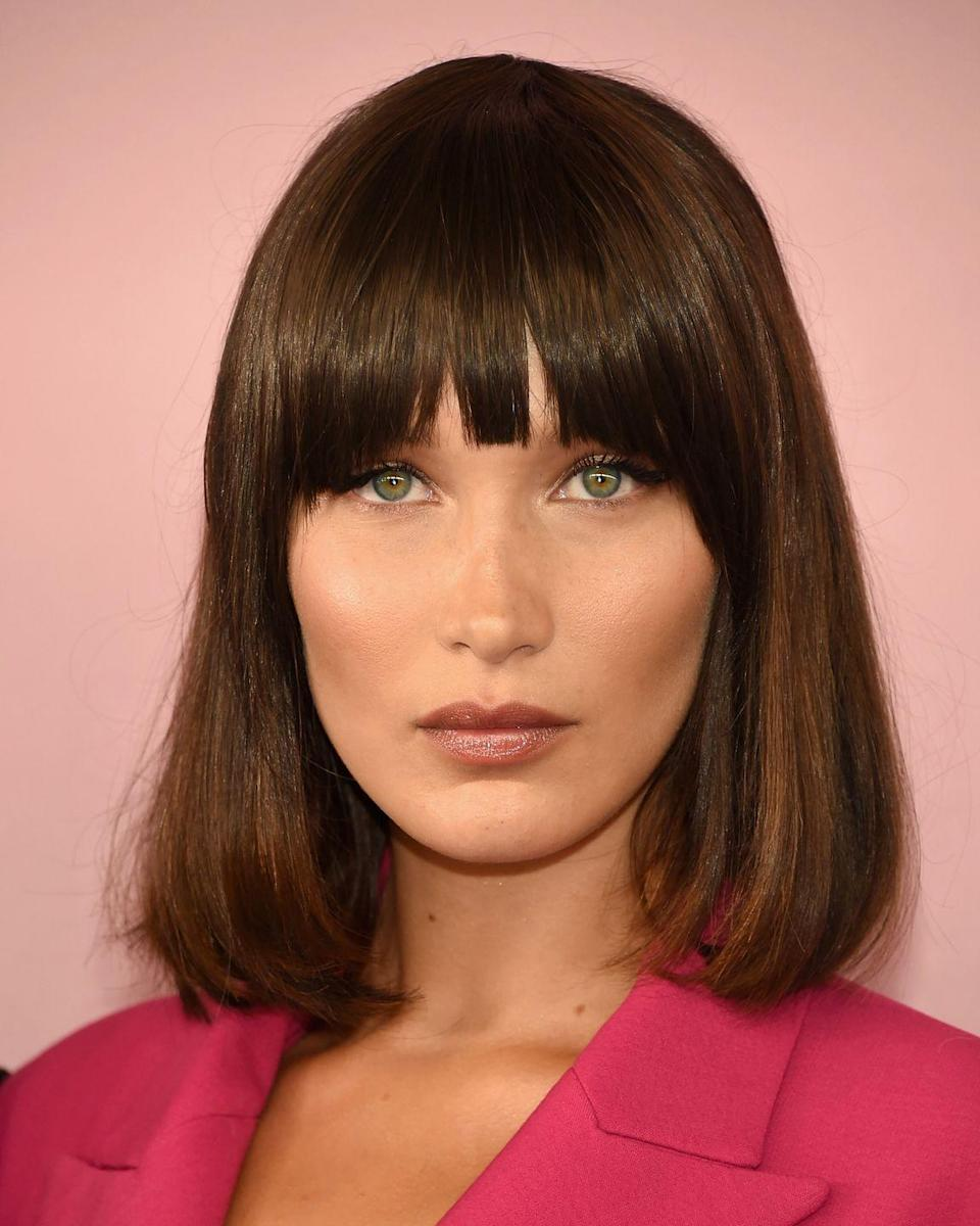 """<p>Bella Hadid officially made the fringe high fashion at last night's CFDA awards. Styled by celeb hair guru Jen Atkin, Bella's faux fringe came courtesy of Beauty Works clip in extensions. </p><p>Recreate Bella's super smooth look by keeping your hair in good condition with a weekly hair mask.</p><p><strong>ELLE Loves...</strong><a href=""""https://www.net-a-porter.com/gb/en/product/766642/Ouai_Haircare/treatment-masque-8-x-9ml"""" rel=""""nofollow noopener"""" target=""""_blank"""" data-ylk=""""slk:OUAI Treatment Masque, £25"""" class=""""link rapid-noclick-resp"""">OUAI Treatment Masque, £25</a></p>"""