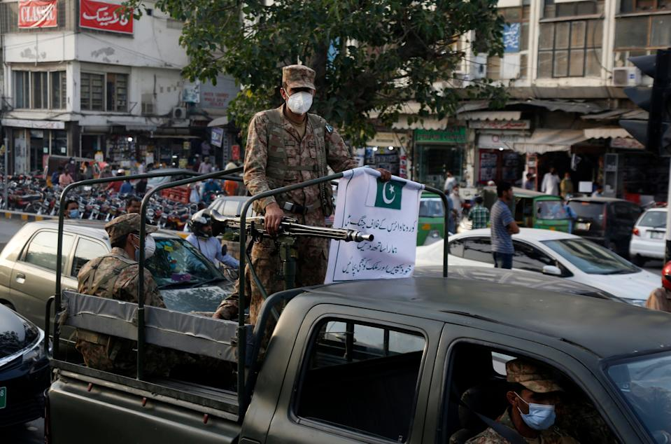 <p>Pakistan army troops patrol in a business district to enforce new restrictions announced  to help control the spread of the coronavirus, in Lahore, Pakistan on 27 April, 2021</p> (AP)