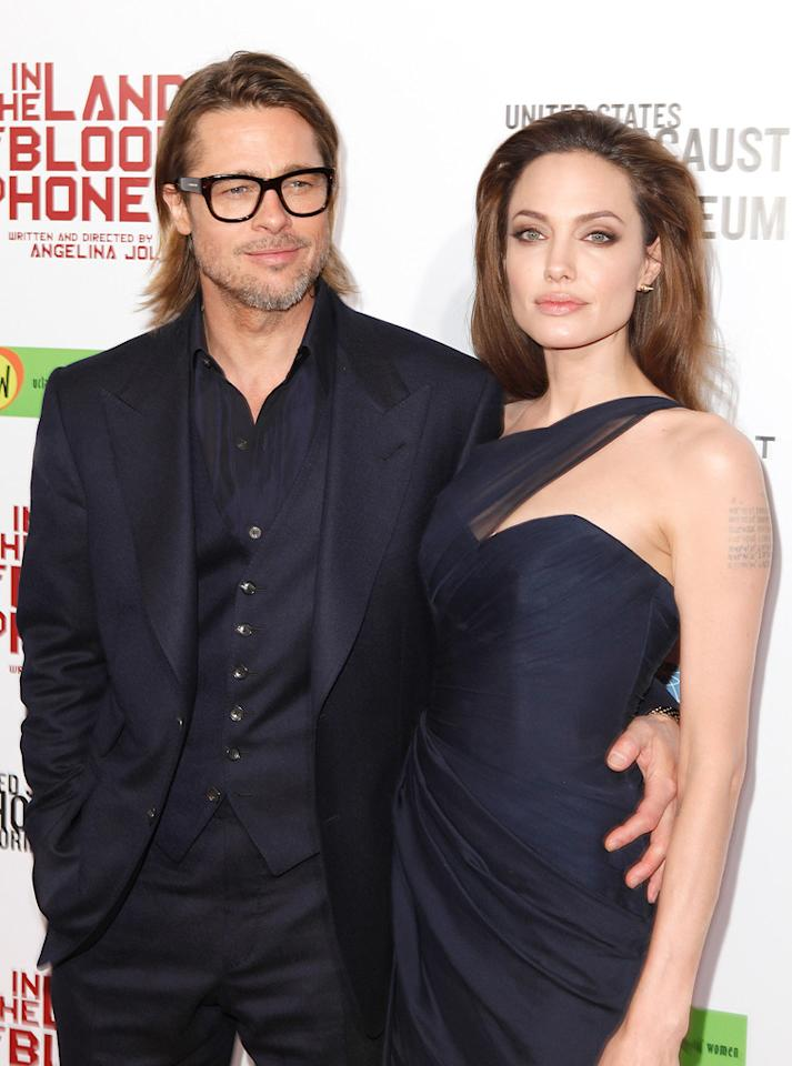 "<a href=""http://movies.yahoo.com/movie/contributor/1800018965"">Brad Pitt</a> and <a href=""http://movies.yahoo.com/movie/contributor/1800019275"">Angelina Jolie</a> at the Los Angeles premiere of <a href=""http://movies.yahoo.com/movie/1810186173/info"">In the Land of Blood and Honey</a> on December 8, 2011."