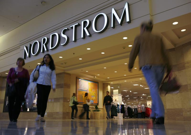 File of shoppers making their way past Nordstrom in Schaumburg