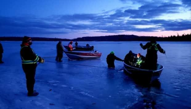 Search crews looking for the three missing snowmobilers on the Churchill River. The bodies of one woman and one man were found in the water on Monday. The body of the second woman was found in the water Tuesday afternoon.  (Jim Searson/Facebook - image credit)