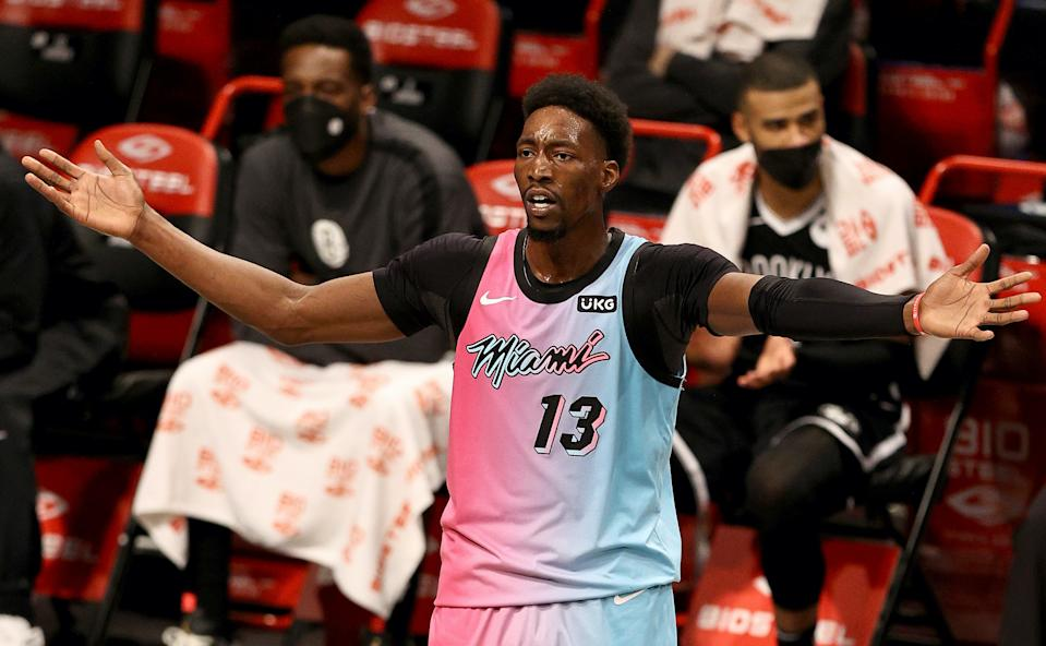 NEW YORK, NEW YORK - JANUARY 23:  Bam Adebayo #13 of the Miami Heat reacts after he thought there should have been a foul against the Brooklyn Nets at Barclays Center on January 23, 2021 in New York City.NOTE TO USER: User expressly acknowledges and agrees that, by downloading and or using this photograph, User is consenting to the terms and conditions of the Getty Images License Agreement. (Photo by Elsa/Getty Images)