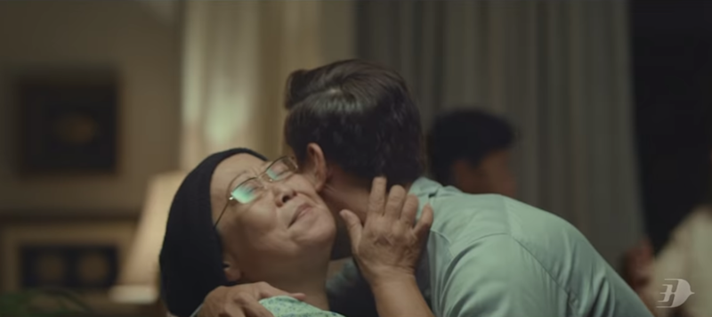 A man in Malaysia Airlines' 'Sama-Sama Balik Kampung' video, embraces his mother after he surprised her by coming home for Hari Raya. — Screengrab via Youtube/ Malaysia Airlines