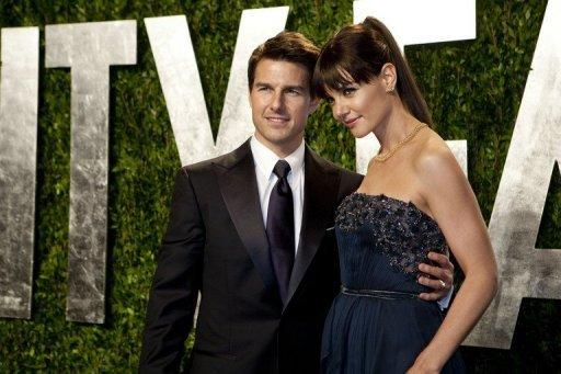 Katie Holmes (R) and Tom Cruise (L) arrive at the Vanity Fair Oscar Party in February 2012 in Hollywood. The couple announced Friday they were calling it quits after five years of marriage, ending an unexpected love story dogged by tabloid rumors