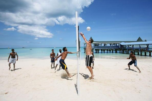 ST. JOHN'S, ANTIGUA AND BARBUDA - APRIL 05: Sri Lankan coach Tom Moody (R) tries to block a smash by Kumar Sangakkara (L) of Sri Lanka as members of the team play beach volleyball, at the Halcyon Cove resort on April 5, 2007 in St. John's, Antigua and Barbuda.  (Photo by Tom Shaw/Getty Images)