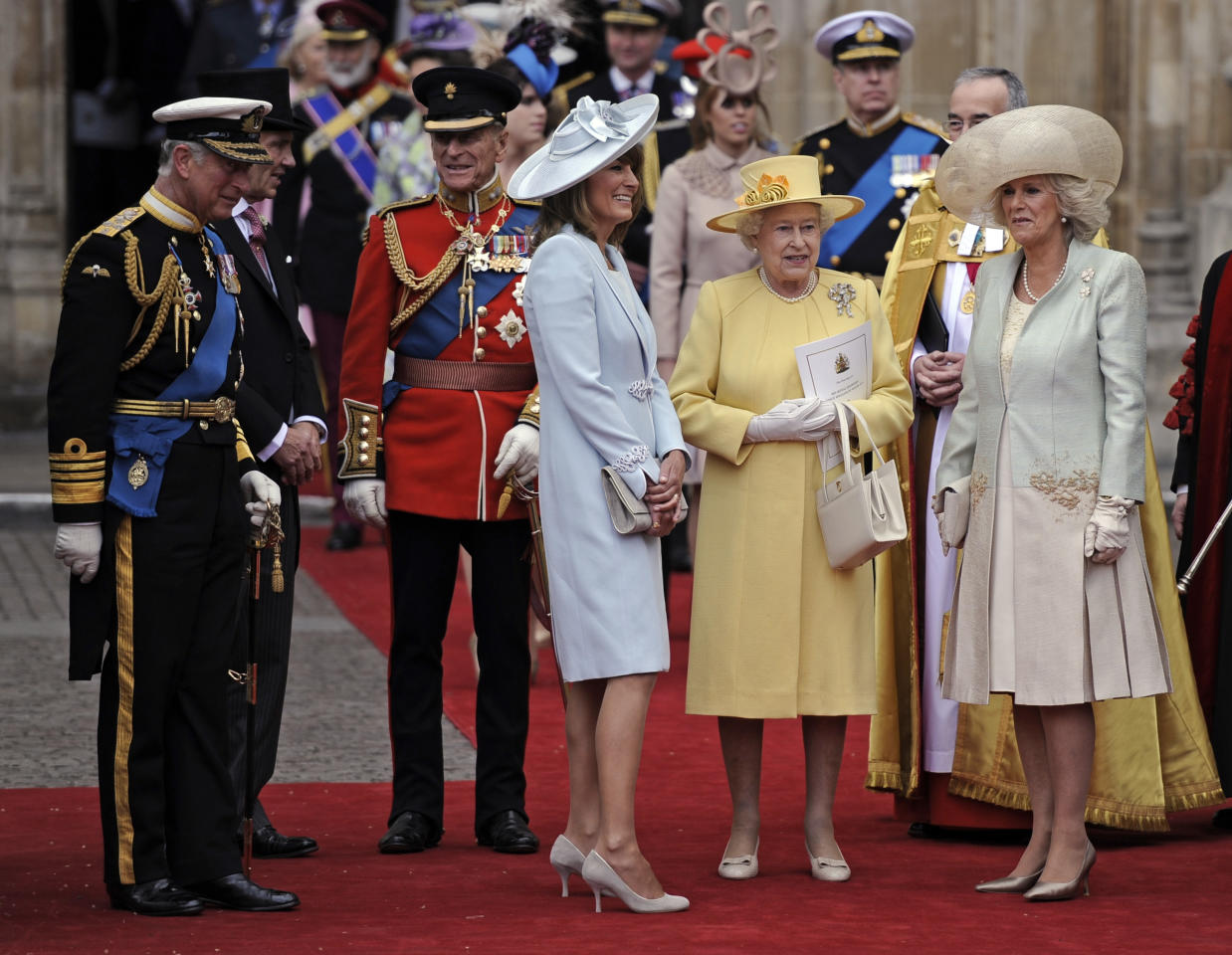From left, Prince Charles, Prince Phillip, Carole Middleton, Britain's Queen Elizabeth II and Camilla, Duchess of Cornwall stand outside of Westminster Abbey after the Royal Wedding in London Friday, April, 29, 2011.