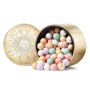 """<p>This gorgeous holiday edition of Guerlain's Météorites Highlighting Powder Pearls look a little bit like a jar of candy your grandmother may keep in her entryway, but it's so much more glamorous than that. The little balls are made of six types of iridescent and <a href=""""https://www.allure.com/gallery/best-setting-powder?mbid=synd_yahoo_rss"""" rel=""""nofollow noopener"""" target=""""_blank"""" data-ylk=""""slk:matte powders"""" class=""""link rapid-noclick-resp"""">matte powders</a> that blend seamlessly to brighten up Grandma's complexion — and her day.</p> <p><strong>$64</strong> (<a href=""""https://www.sephora.com/product/guerlain-meteorites-festive-highlighting-powder-pearls-P464254"""" rel=""""nofollow noopener"""" target=""""_blank"""" data-ylk=""""slk:Shop Now"""" class=""""link rapid-noclick-resp"""">Shop Now</a>)</p>"""