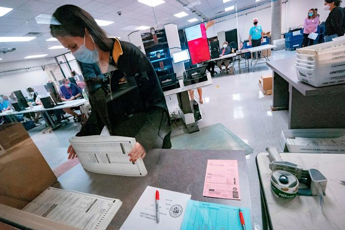 A poll worker sorts ballots inside the Maricopa County Election Department in Phoenix on Nov. 5, 2020. (Photo: OLIVIER  TOURON/AFP via Getty Images)