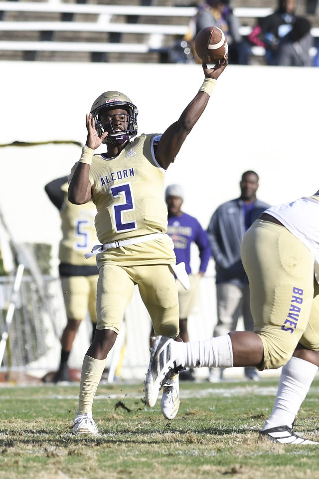 Alcorn State quarterback Felix Harper (2) releases a pass against Jackson State during the first half of an NCAA college football game in Jackson, Miss., Saturday, Nov. 23, 2019. (Courtland Wells/The Vicksburg Post via AP)