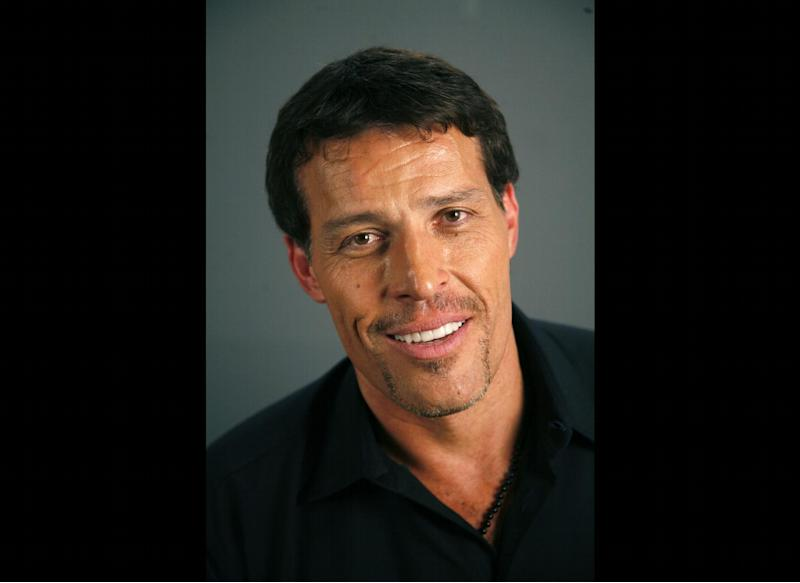 FILE - Tony Robbins poses for a portrait Monday, July 26, 2010 in New York. Fire officials in California say at least 21 people were treated for burns after attendees of an event for motivational speaker Tony Robbins tried to walk on hot coals. (AP Photo/Jeff Christensen, File)
