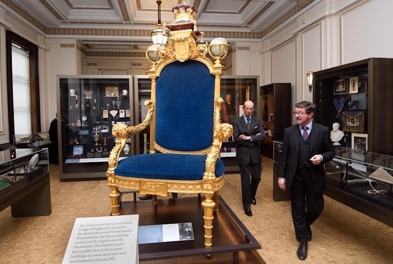 <strong>Prince Edward, Duke of Kent, left, also the 10th Grand Master of the United Grand Lodge of England, is shown the Grand Master's chair by Curator Mark Dennis </strong> (Carl Court via Getty Images)